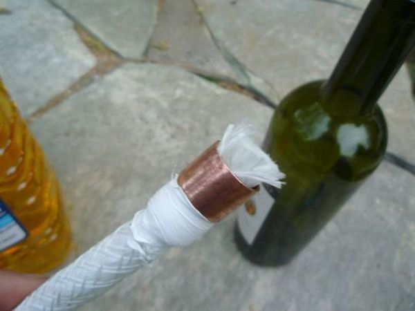 How to make a tiki torch from an empty wine bottle for Diy beer bottle tiki torches