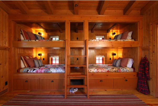Bunk Beds For Four Separated By A Built In Storage Cabinet View