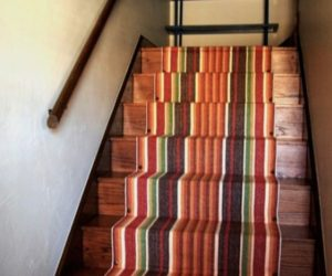 Decorate your stairway with a striped carpet