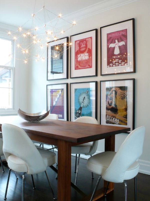 living room posters.  living room featuring a wall covered with vintage posters View How to decorate using