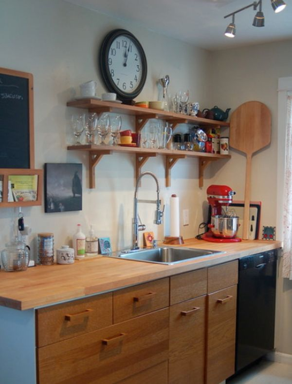 Kitchen Featuring A White Clock Mechanism View