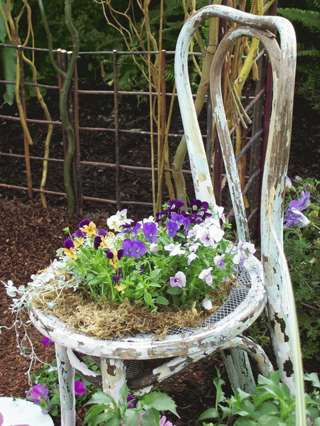 View in gallery & Turn old chairs into beautiful flower beds and planters