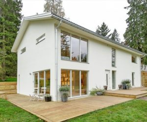A house that's plain and simple on the outside but refreshing and dynamic on the inside