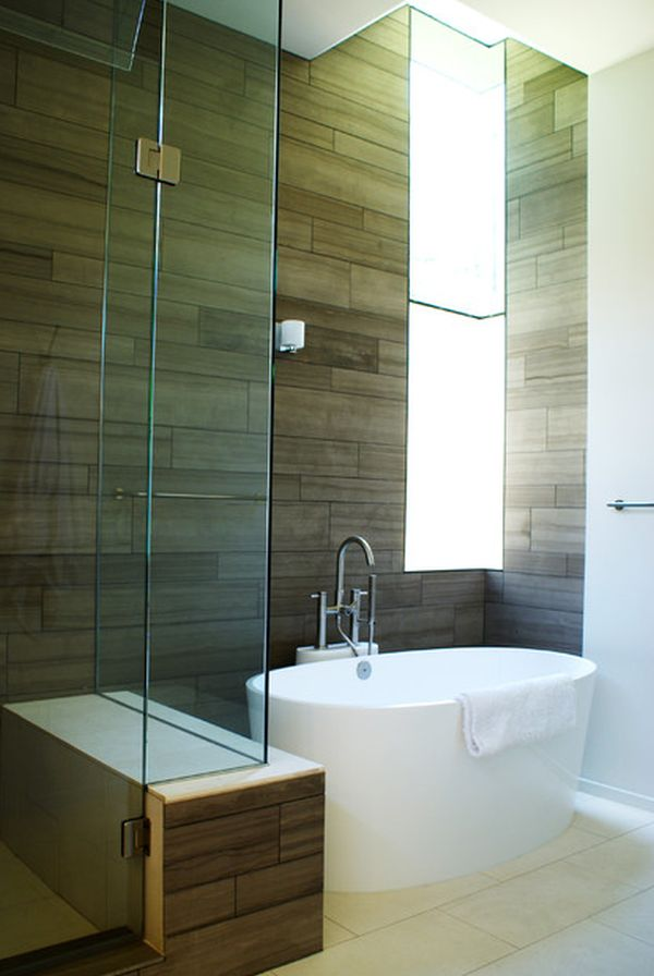... bathroom featuring a small tub, wooden floors and a comfy armchair View  ...