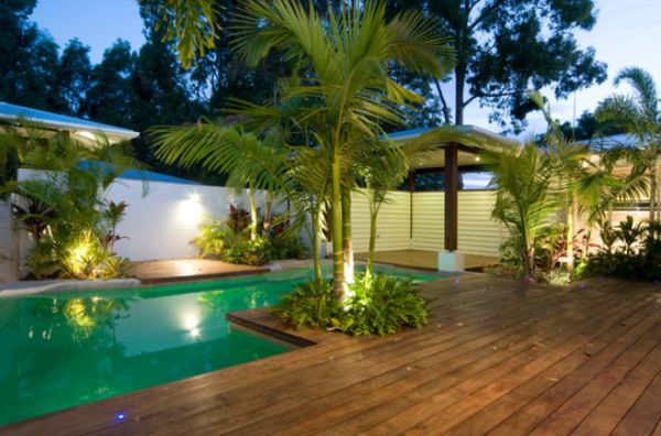View In Gallery Tropical Outdoor Pool With A Simple Wooden Deck ...