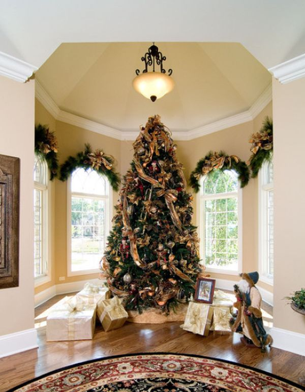 christmas tree with white ornaments and golden lights view