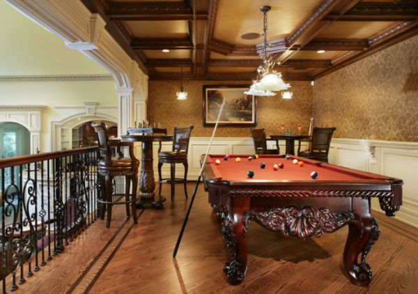 view in gallery dramatic billiards room featuring an elegant chandelier and rich wooden features view