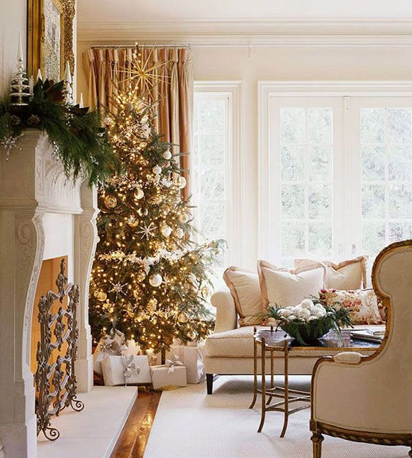 christmas tree wrapped in lights and shiny ornaments view - White Christmas Tree With Gold Decorations