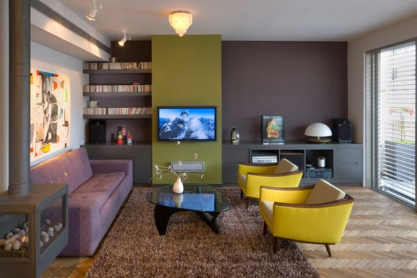 Living room featuring a brown accent wall with an ochre focal point behind the TV