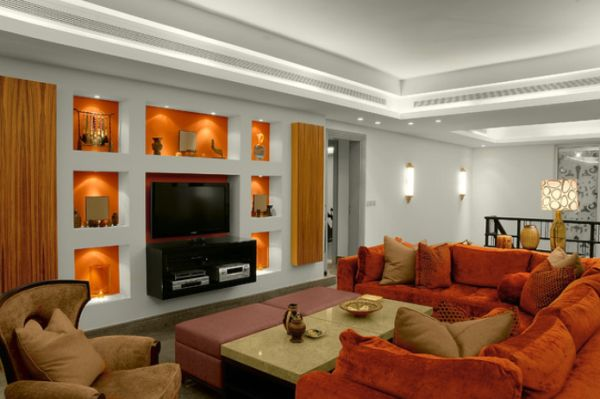 Inviting family room featuring a white and orange décor with bold focal points on the wall