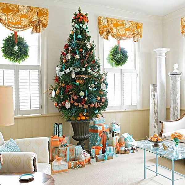 ornaments and decorations with matching gifts underneath view - Orange Coloured Christmas Tree Decorations