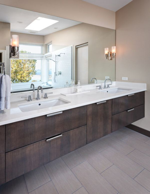 View in gallery Contemporary bathroom featuring a suspended vanity with two undermount sinks