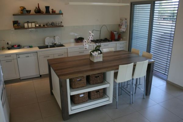 The Kitchen Island Often Serves As A Bar Table View In Gallery