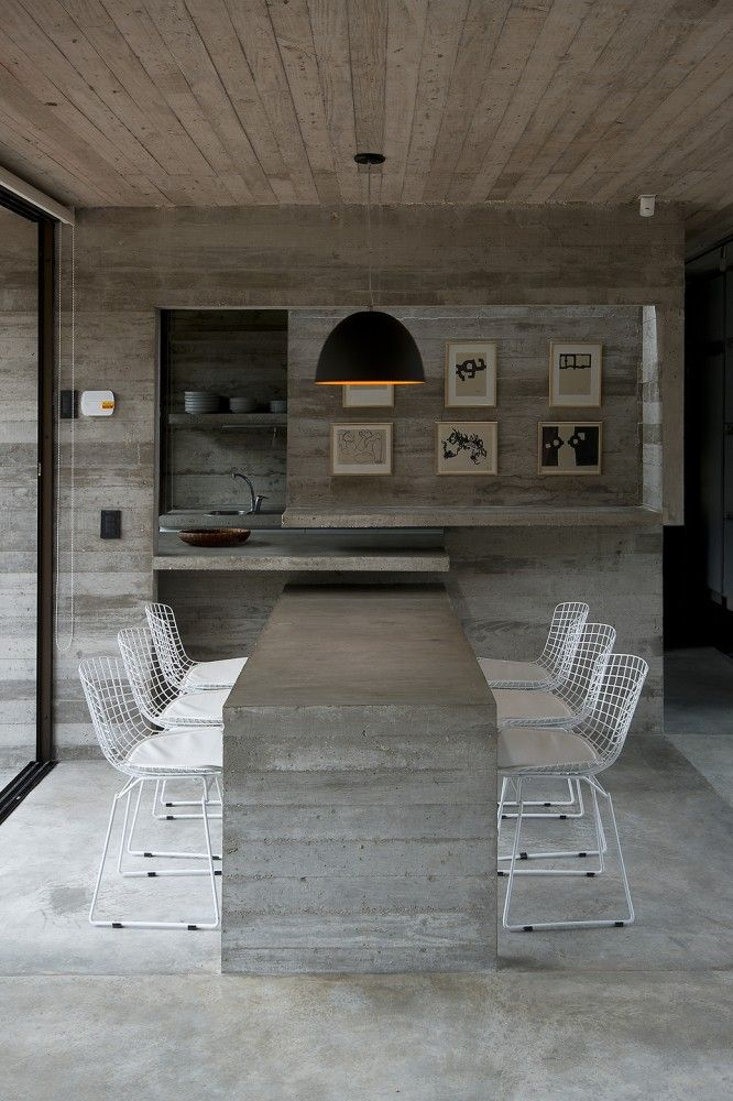 contrast between concrete and chairs