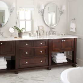 under vanity open storage dark bathroom