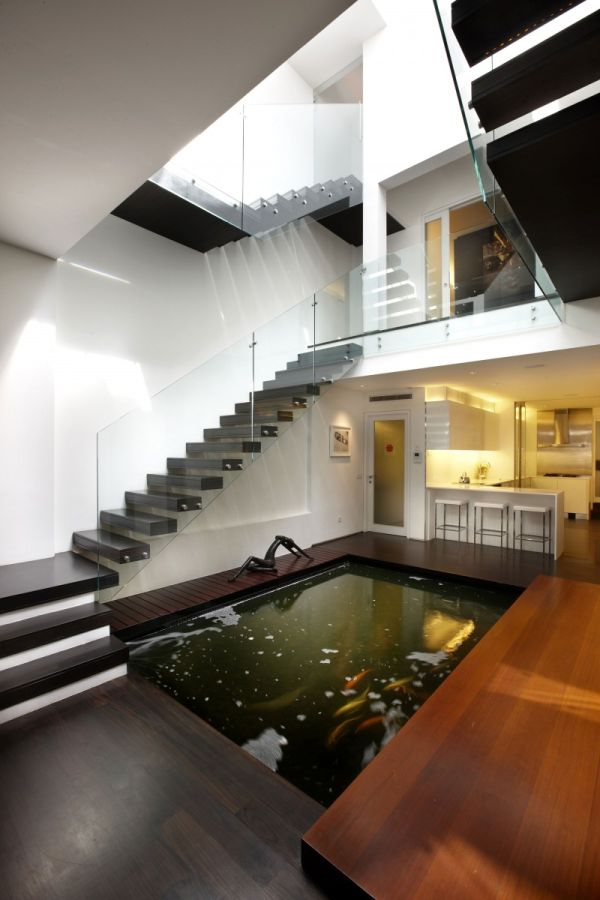 Renovated Residence In Singapore With A Koi Pond Inside