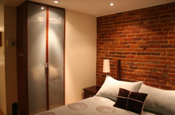 charming design red wall bedrooms | A brick wall – always a charming décor feature in any room