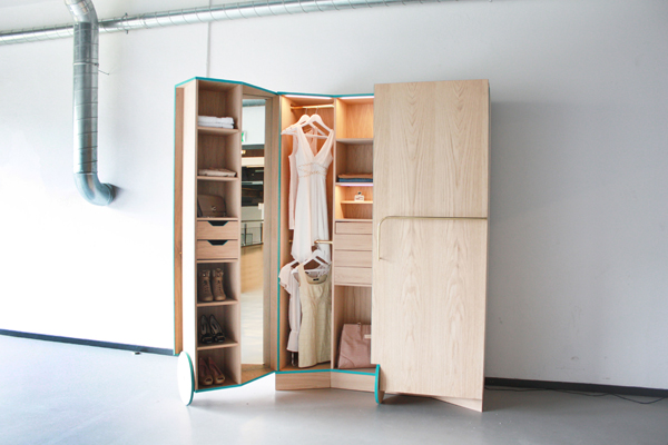 A Compact Walk In Closet With Tons Of Hidden Storage