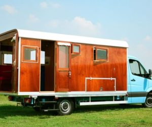 A Mobile Home With A Wooden Exterior And A Retro Look