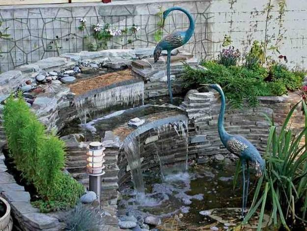 ... Bird decorations can make a small waterfall stand out - 25 Backyard Waterfalls To Include In Your Landscaping