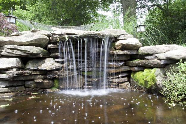 You don't need a lot of room to add a waterfall. It can be small and charming
