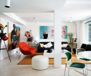 A minimalist white décor complemented by bold colors and striking artwork
