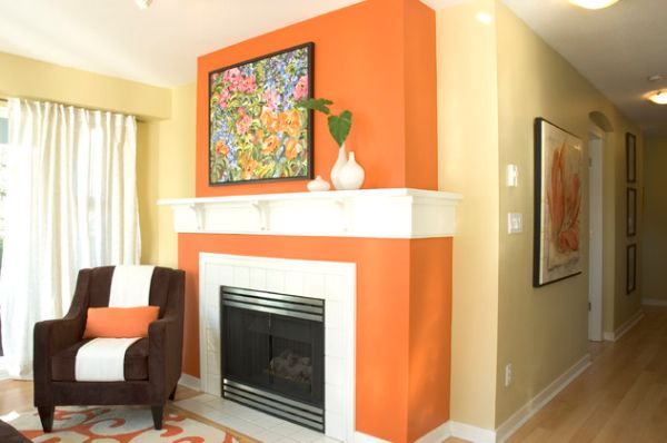 The underused interior design color how to use orange - Burnt orange feature wall living room ...