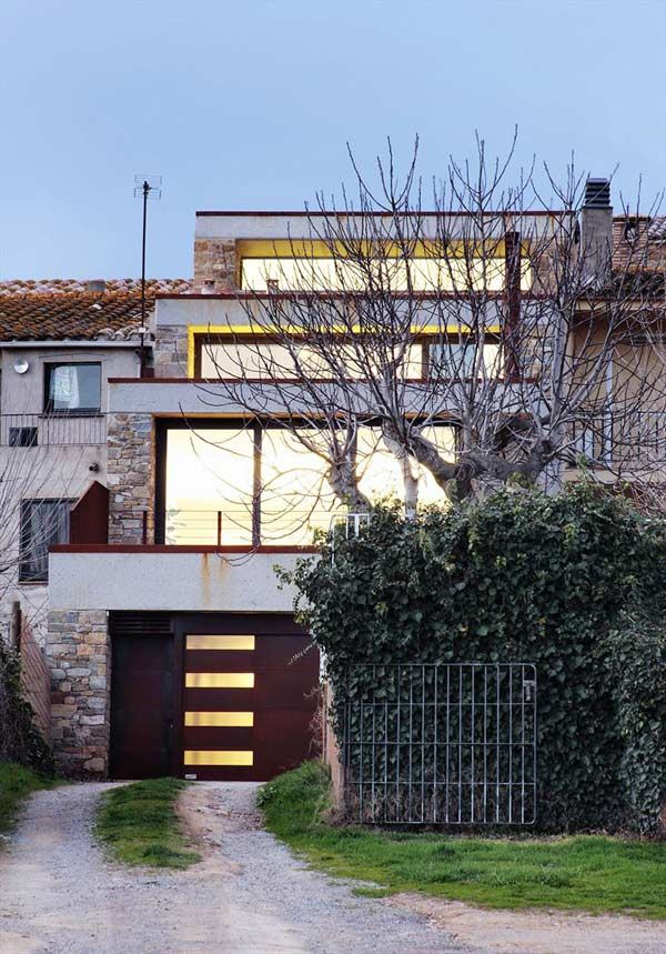 Terraced Girona Home With A Cascading Design And Bold Yellow Accents