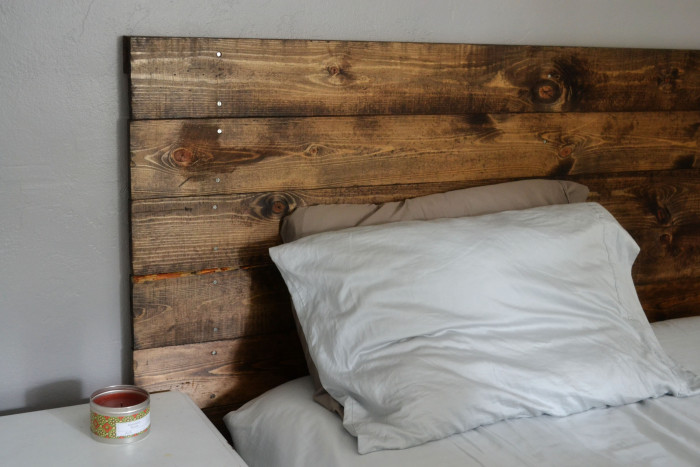 ... Add a reclaimed wood headboard to a bedroom decorated with cool colors  ...
