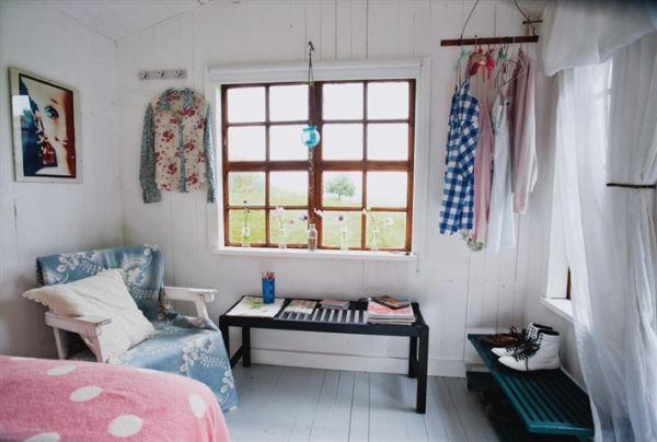 Tiny Garden House Featuring A Feminine Design