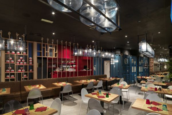 How commercial spaces use recycled materials in beautiful for Restaurant reggio emilia