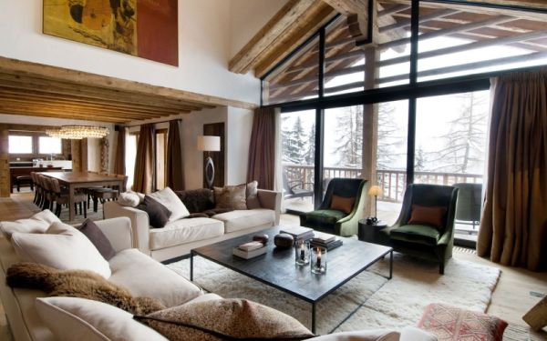 The fluffy rugs and soft textures create a very cozy décor & Chalet Dent Blanche - Hidden Away In The Swiss Mountains
