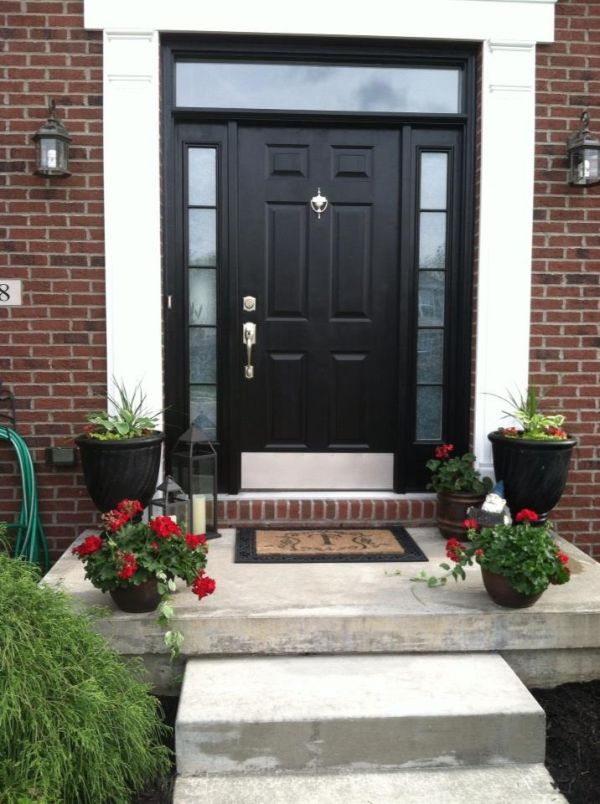 Stylish black front doors change your house 39 s curb appeal for Houses with double front doors