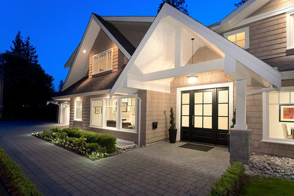 Stylish black front doors change your house 39 s curb appeal for Main front house design