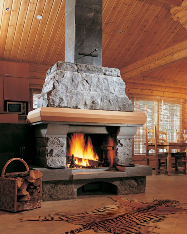 34 beautiful stone fireplaces that rock for Back to back indoor outdoor fireplace