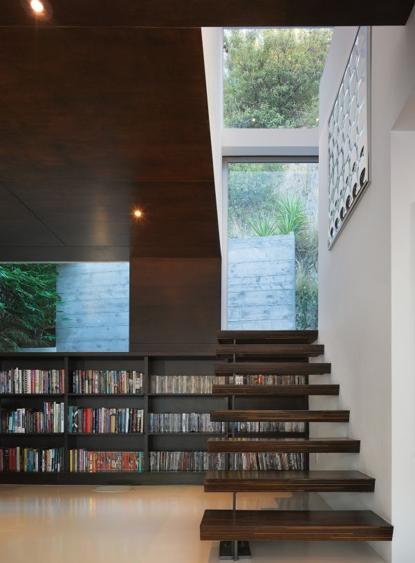Bookshelves Under The Stairs.