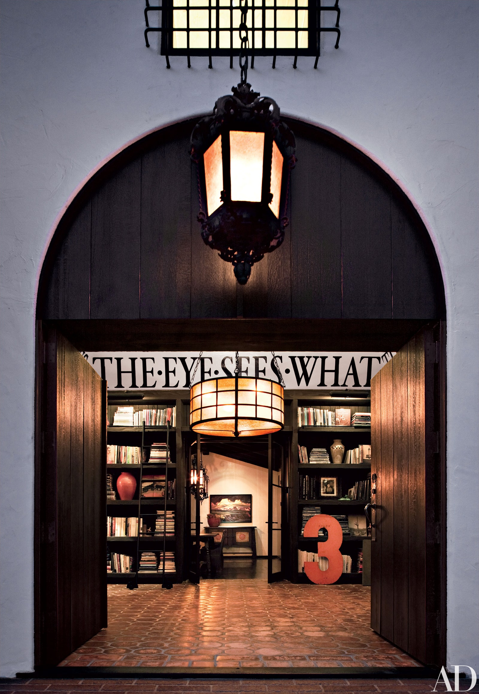 home library 63. Place a Quote Over Your Bookshelves for Inspiration