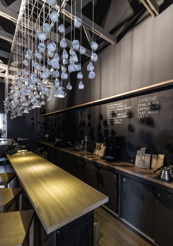 origo coffee shop painted beams and chalkboard - Modern Cafe Ideas
