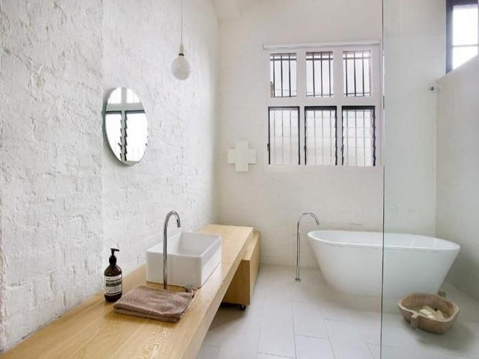 ... Modern Bathroom Which Preserves Some Of The Old Charm View In Gallery A Brick  Wall ... Gallery