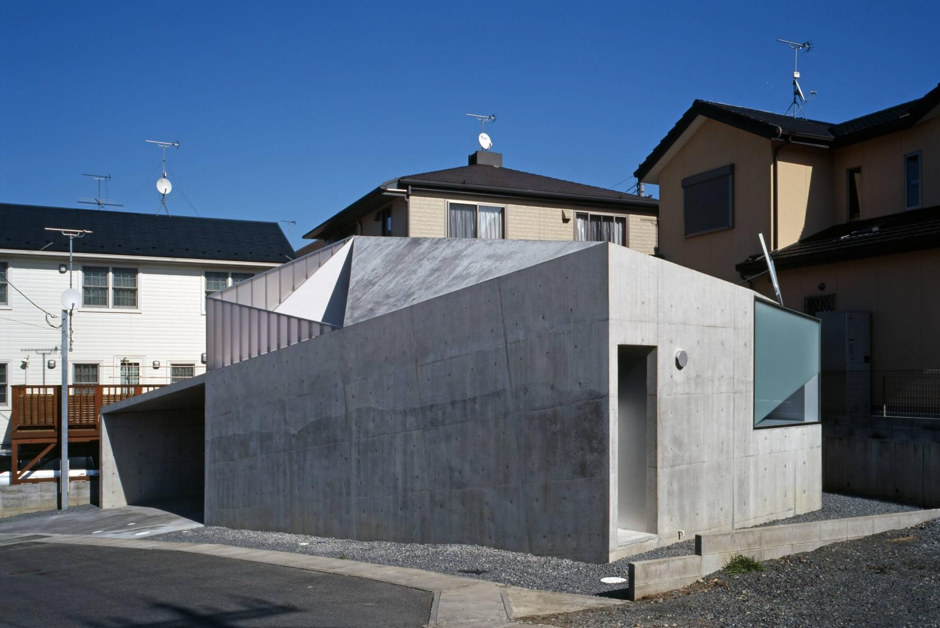 Modern Concrete House Built On A Budget And Featuring An Irregular Shape