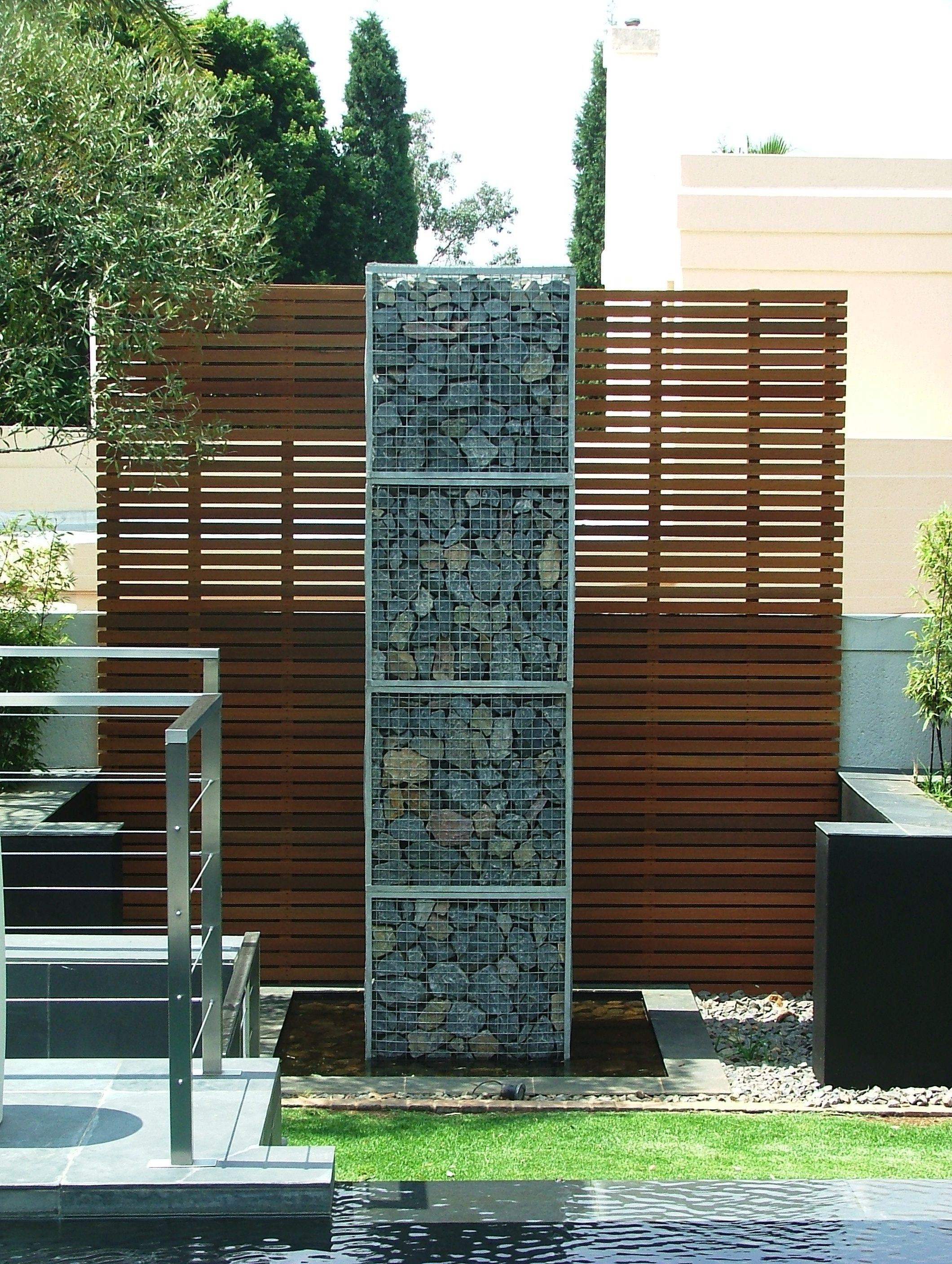 gabion walls what they are and how to use them in your landscape. Black Bedroom Furniture Sets. Home Design Ideas