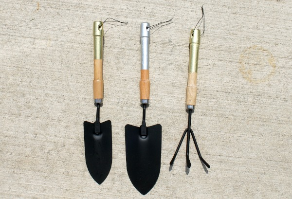 silver and gold garden tools