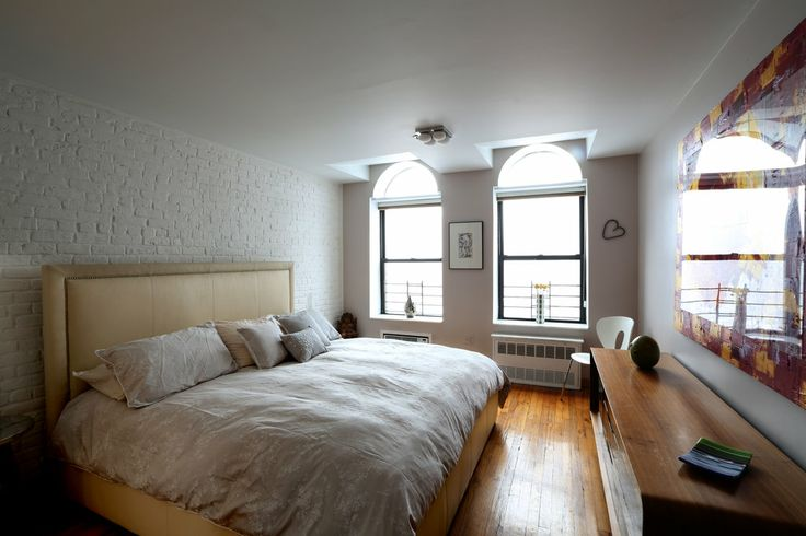 Painting brick walls white an increasingly popular trend for Bedroom w brick wall