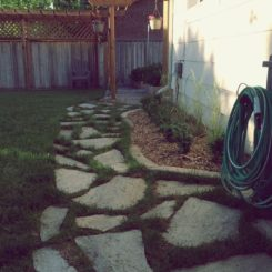 How to Lay a Flagstone Walkway in an Existing Lawn