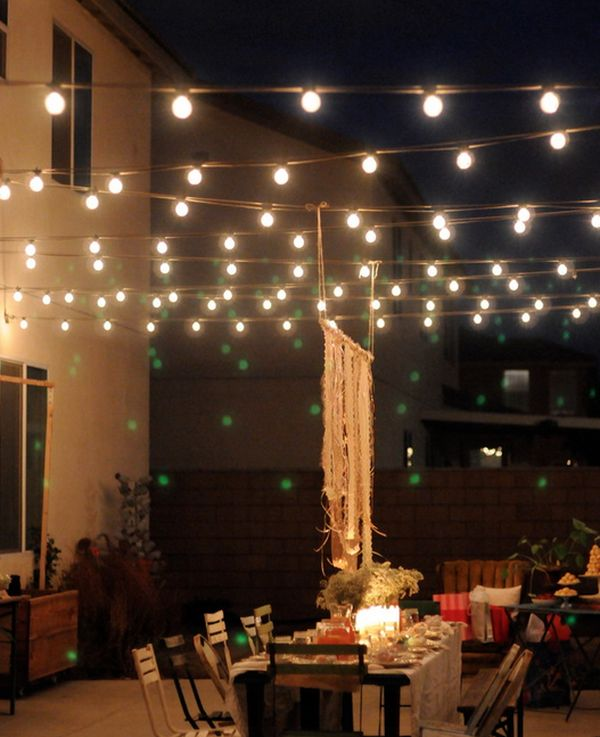 Outdoor magic how to decorate with fairy lights for How to decorate a backyard