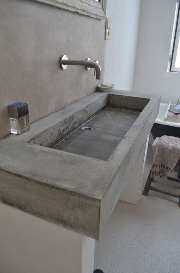 Concrete bathroom sinks that make a strong statement for Base para lavadero
