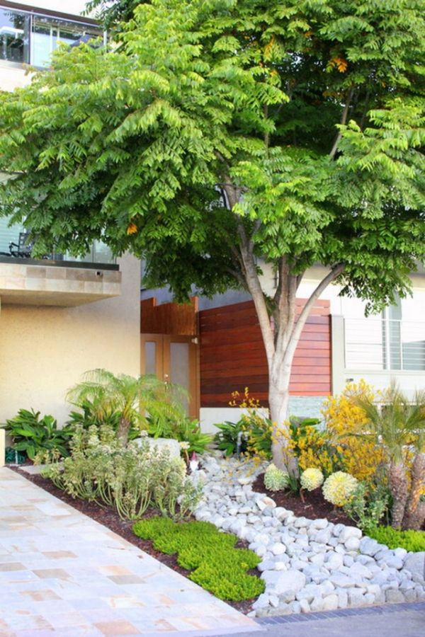 playing with river stones - Modern Front Yard Garden Ideas
