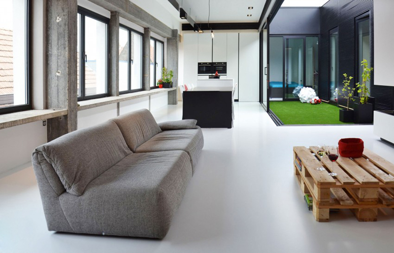 modern loft in a converted textile factory brings outdoor freshness in. Black Bedroom Furniture Sets. Home Design Ideas