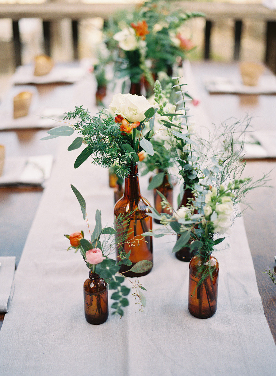 Empty glass bottles fill in as gorgeous wedding centerpieces junglespirit Gallery