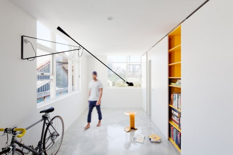 Micro Apartment Hides Its Playful Decor Behind Sliding Doors